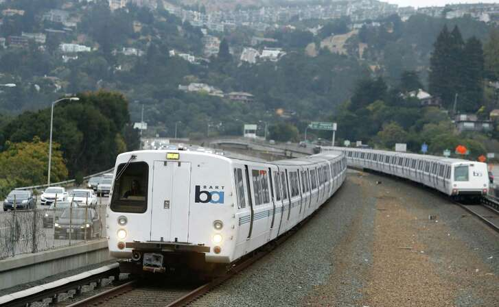 Trains arrive and depart at the Rockridge BART station in Oakland, Calif.
