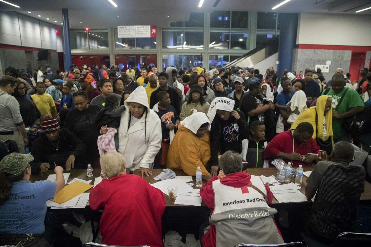 Thousands take shelter from Hurricane Harvey at the George R. Brown Convention Center, Monday, Aug. 28, 2017, in Houston.
