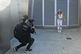 """Liz Bezler performs during the filming of her music video for """"Tell Me Nada"""" with the help of videographer Chris Koehl."""