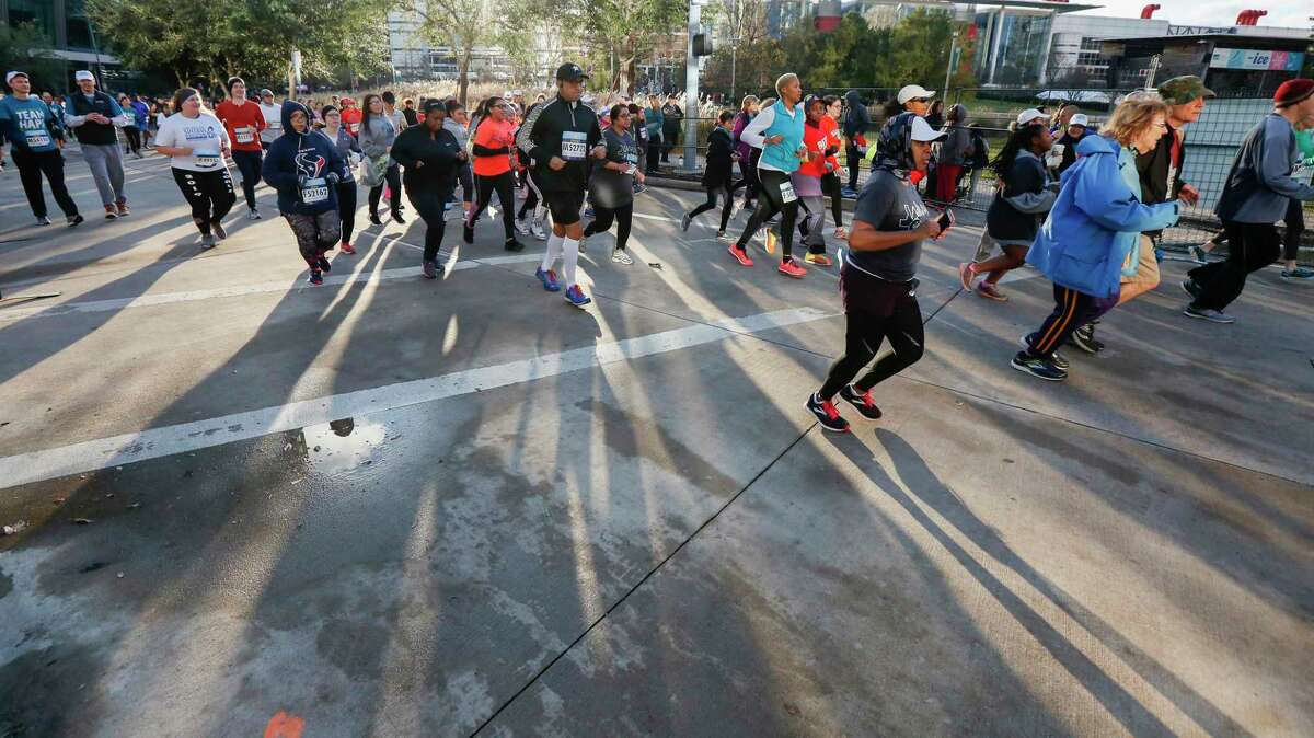 Runners hit the streets early as they participate in the We Are Houston 5K presented by Aramco and Chevron Saturday, Jan. 19, 2019, in Houston.