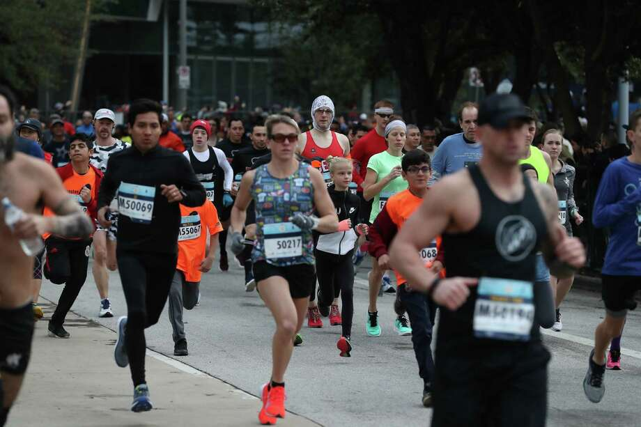 Runners participate in the We Are Houston 5K presented by Aramco and Chevron Saturday, Jan. 19, 2019, in Houston. Photo: Steve Gonzales, Staff Photographer / © 2019 Houston Chronicle