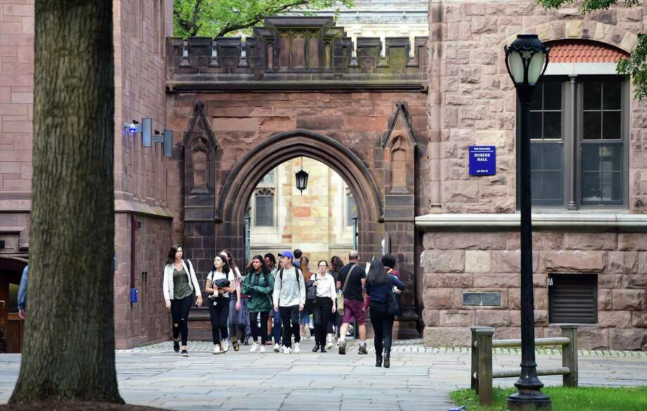 Students walk into Yale University's Old Campus in New Haven on October 2, 2018. Photo: Arnold Gold / Hearst Connecticut Media / New Haven Register