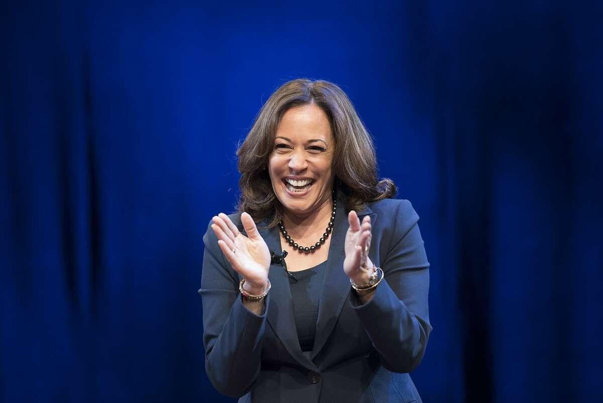 "Kicking off her book tour, Sen. Kamala Harris, D-Calif., greets the audience at George Washington University in Washington, Wednesday, Jan. 9, 2019. Harris describes herself as a ""progressive prosecutor"" in her memoir. (AP Photo/Sait Serkan Gurbuz)"