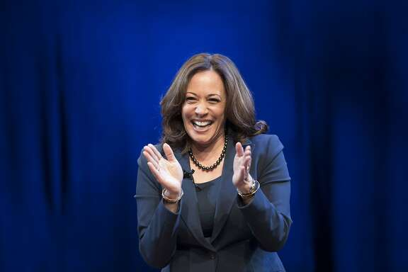 "Kicking off her book tour, Sen. Kamala Harris, D-Calif., greets the audience at George Washington University in Washington, Wednesday, Jan. 9, 2019. Harris describes herself as a ""progressive prosecutor"" in her memoir. (AP Photo/Sait Serkan Gurbuz)"