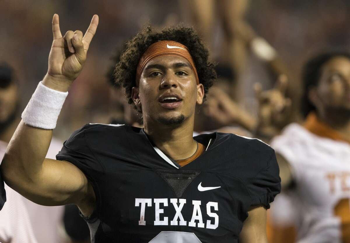"""Casey Thompson, standing for """"Eyes of Texas"""" after spring game in 2018. Changing the song is part of several requests from Longhorn athletes to address historic racism on campus."""