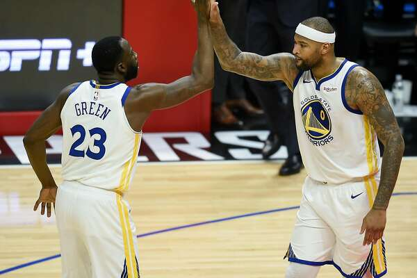 For Warriors, DeMarcus Cousins an energizing presence