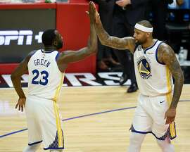 Golden State Warriors center DeMarcus Cousins, right, celebrates with forward Draymond Green during the third quarter against the Los Angeles Clippers on Friday, Jan. 18, 2019 in Los Angeles, Calif.