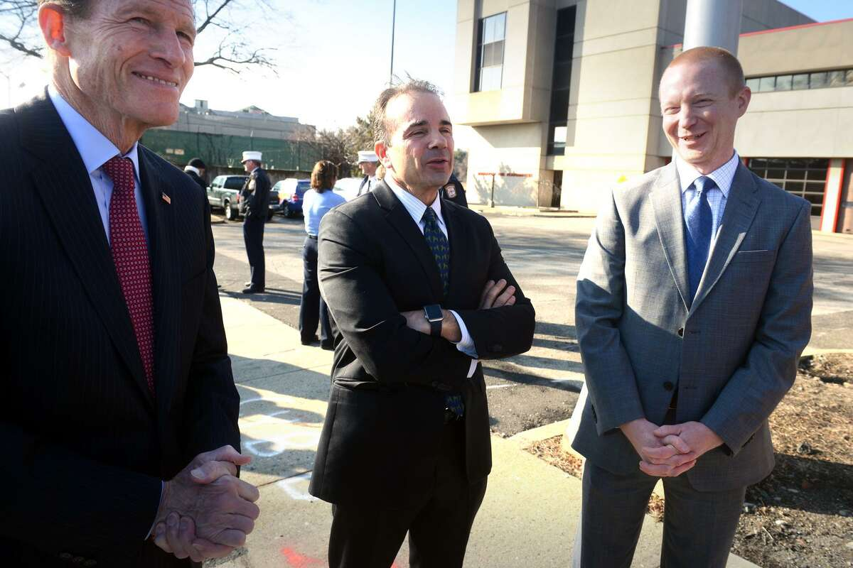 Mayor Joe Ganim, center, talks with Senator Richard Blumenthal, left, and structural engineer Jon Ives, of Aecom Engineering, prior to a press conference at the old Congress Street bridge, in Bridgeport, Conn. Jan. 18, 2019. Ganim announced that plans to replace the bridge are moving forward. Ives is the structural engineer who is designing the new span.