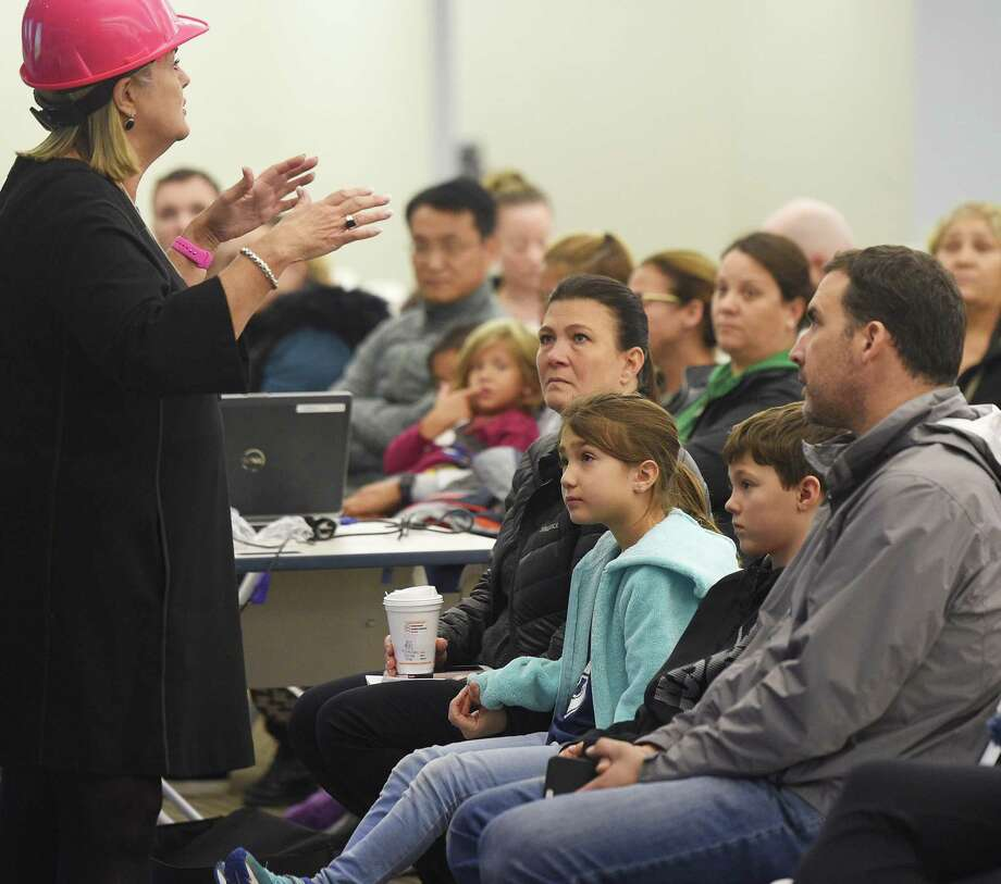 Parents and students attend an open house for the new Westover Magnet Elementary School, dubbed Westover @ 1 Elmcroft, in the Harbor Point neighborhood of Stamford, Conn. Tuesday, Nov. 13, 2018. Students were required to relocate after a severe mold problem was found in the school, so kids will now attend school in an office building with certain floors repurposed to suit students' learning needs. Photo: Tyler Sizemore / Hearst Connecticut Media / Greenwich Time