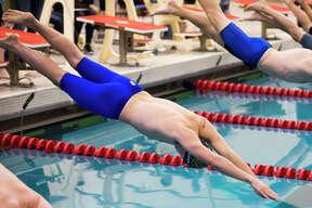 Midland's Ryan Freed competes in the 50 meter freestyle during a Tri-Cities swim meet on Saturday, Jan. 19, 2019 at SVSU. (Katy Kildee/kkildee@mdn.net)