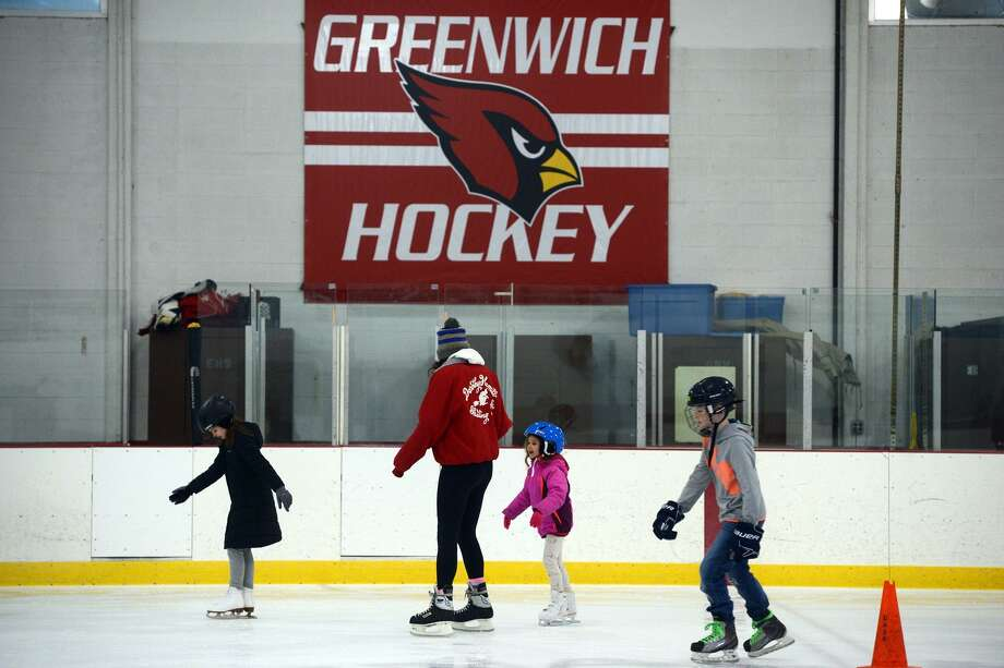 Residents participate in a public skating session at Dorothy Hamill Rink, in Greenwich, Conn. Dec. 28, 2018. A new rink is one of the possible capital projects to be addressed in the town budget. Photo: Ned Gerard / Hearst Connecticut Media / Connecticut Post