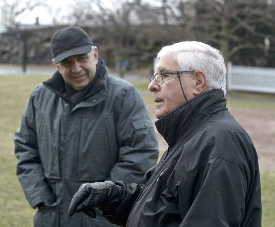 Sylvester Pecora , RTM member from District 3, talks about the field at Hamilton Avenue School. Looking on is school principal John Grasso. Pecora and others from the area would like to see improvements to the schools field, they feel it is in poor condition. Friday, January 19, 2019, in Greenwich, Conn. Photo: H John Voorhees III / Hearst Connecticut Media / The News-Times