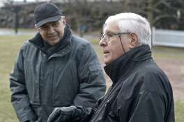 Sylvester Pecora , RTM member from District 3, talks about the field at Hamilton Avenue School. Looking on is school principal John Grasso. Pecora and others from the area would like to see improvements to the schools field, they feel it is in poor condition. Friday, January 19, 2019, in Greenwich, Conn.