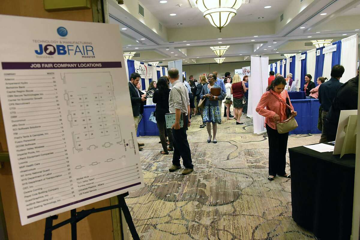 Job seekers visit company vendors during the Times Union Job Fair for manufacturing and technology openings in and around the Capital Region at the Albany Marriott hotel on Tuesday, Sept. 18, 2018 in Colonie, N.Y. (Lori Van Buren/Times Union)