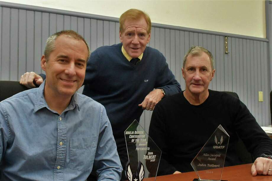 From left, John Bysiewicz, John Courtmanche and John Tolbert of the Faxon Law New Haven Road Race committee. Photo: Bill O'Brien