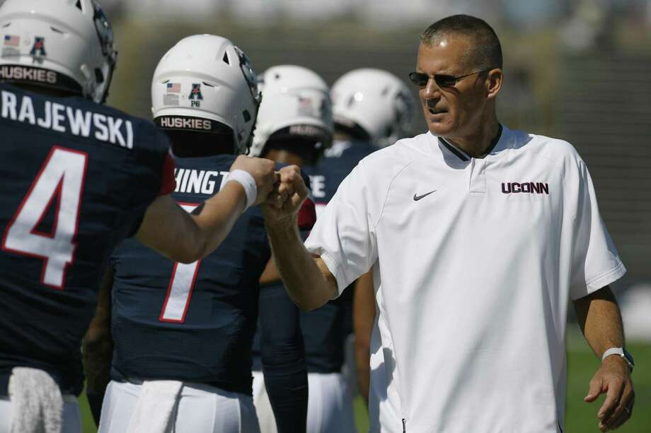 UConn coach Randy Edsall fist bumps Steven Krajewski (4) during a game on Sept. 15 in East Hartford. Photo: Jessica Hill / Associated Press / Copyright 2018. The Associated Press. All rights reserved.