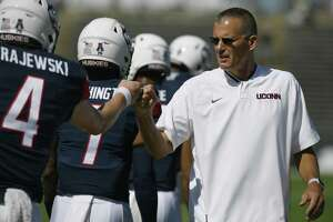 UConn coach Randy Edsall fist bumps Steven Krajewski (4) during a game on Sept. 15 in East Hartford.
