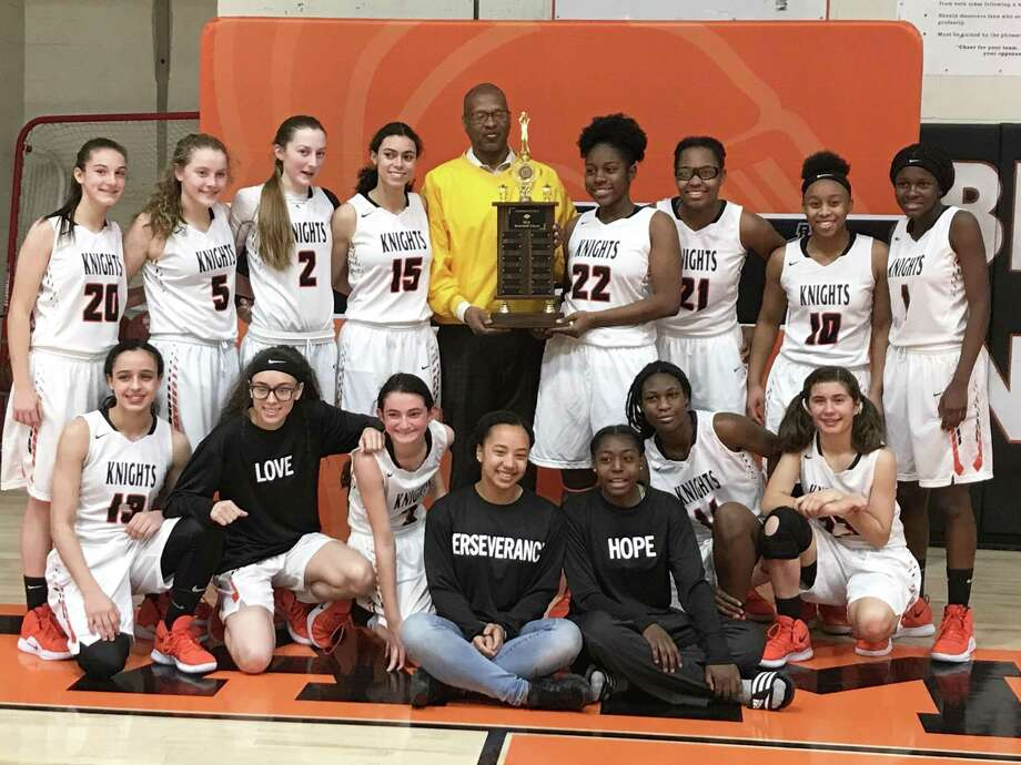 Stamford High was awarded the MLK Classic trophy by NAACP Stamford Chapter president Jack Bryant following its 49-17 victory over Westhill Saturday. Photo: Scott Ericson / Hearst Connecticut Media