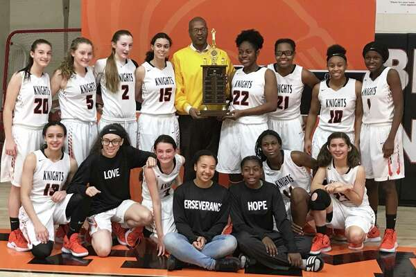Stamford High was awarded the MLK Classic trophy by NAACP Stamford Chapter president Jack Bryant following its 49-17 victory over Westhill Saturday.