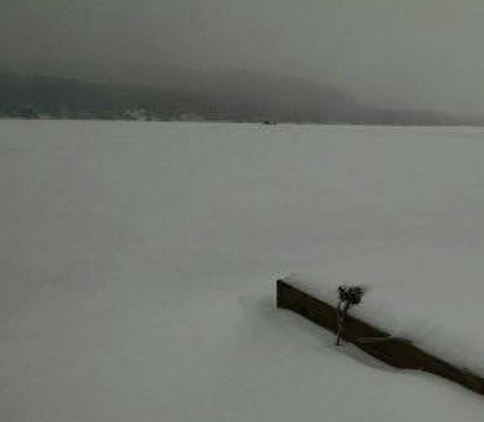 Ice fishermen are seen in the distance on Great Sacandaga Lake. (Tim Blydenburgh / Times Union)