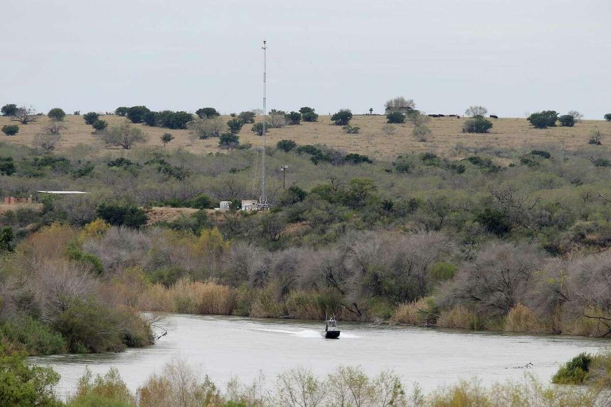 A U.S. Border Patrol boat patrols the Rio Grande between Roma, Texas and Ciudad Miguel Aleman, Texas, Wednesday, Jan. 9, 2019. Behind the boat is USBP surveillance tower.