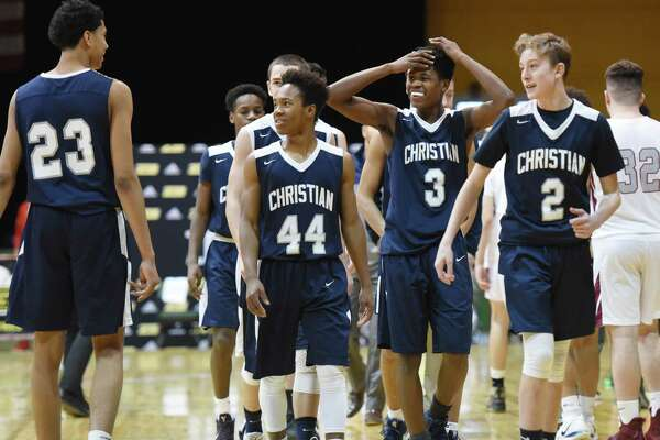 Mekeel Christian Academy players celebrate their close win over Watervliet Saturday, Jan. 19, 2019 at the Washington Avenue Armory in Albany, N.Y. (Phoebe Sheehan/Times Union)
