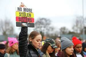"Jessica Felicietti holds up a sign reading ""no more stolen sisters"" during a moment of silence for missing and murdered indigenous woman at the third annual Women's March from Cal Anderson Park to Seattle Center, Saturday, Jan. 19, 2018. Thousands came out to protest Trump Administration policies including those concerning women's health, immigration and environmental issues."
