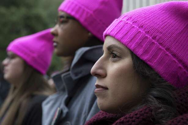 Friends Jenifer Santos (CQ), from right, Raina Bailey and Stephanie Lou wear pink pussyhats to participate the Houston Women March On rally at Houston City Hall on Saturday, Jan. 19, 2019, in Houston.