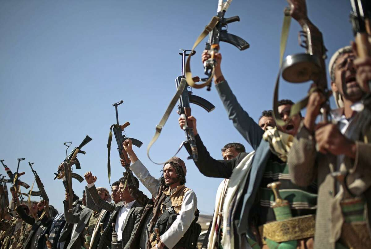 Fighters loyal to Houthi rebels gather last month in Yemen's capital of Sanaa. U.N. experts blame both sides in the war for violating international law and causing a humanitarian crisis.