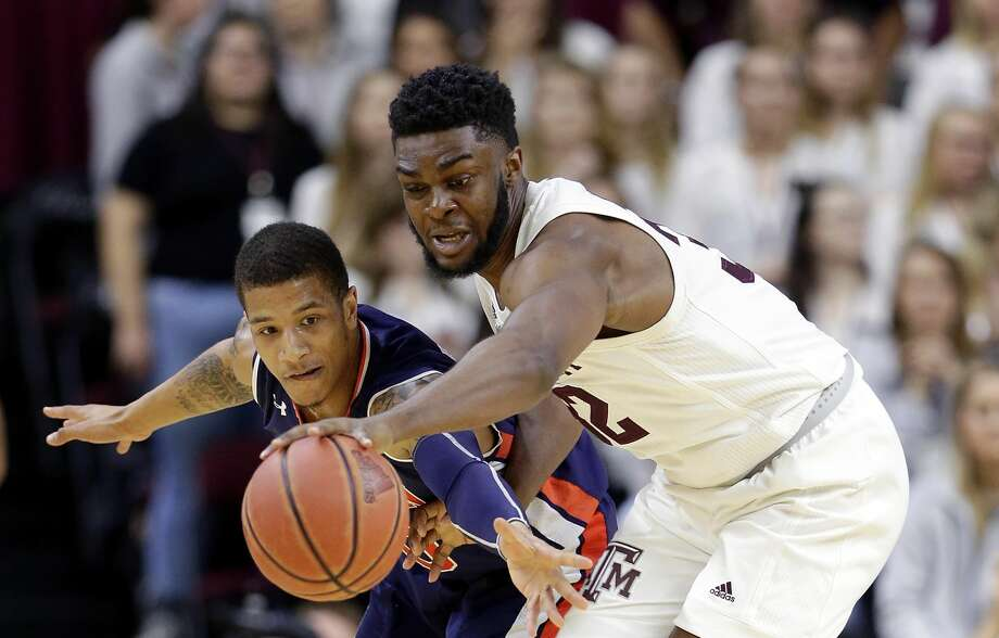 Auburn guard Samir Doughty, left, loses a loose ball scramble to Texas A&M forward Josh Nebo during the first half of an NCAA college basketball game, Wednesday, Jan. 16, 2019, in College Station, Texas. Nebo led the Aggies with 12 points against Missouri on Saturday, Jan. 19, 2019. (AP Photo/Michael Wyke) Photo: Michael Wyke/Associated Press