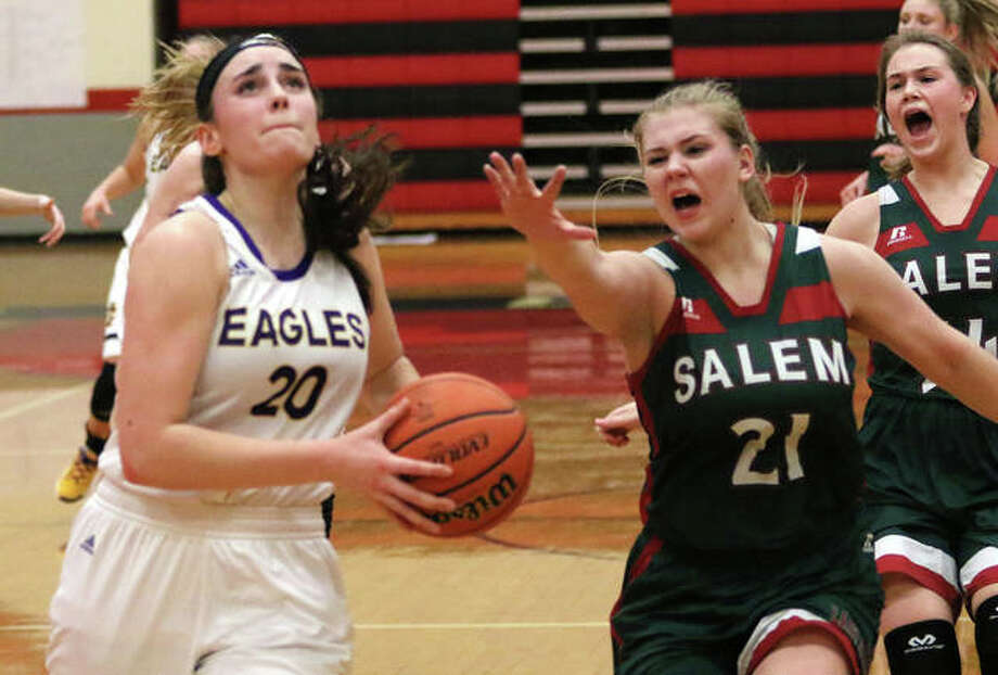 Civic Memorial junior Anna Hall (left) beats Salem's Taylor Gillett (21) and Chloe Harness for a basket off the break in the Eagle's first-round victory Monday at the Highland Tournament. Hall scored a career-high 36 points in the win. Photo: Greg Shashack / The Telegraph