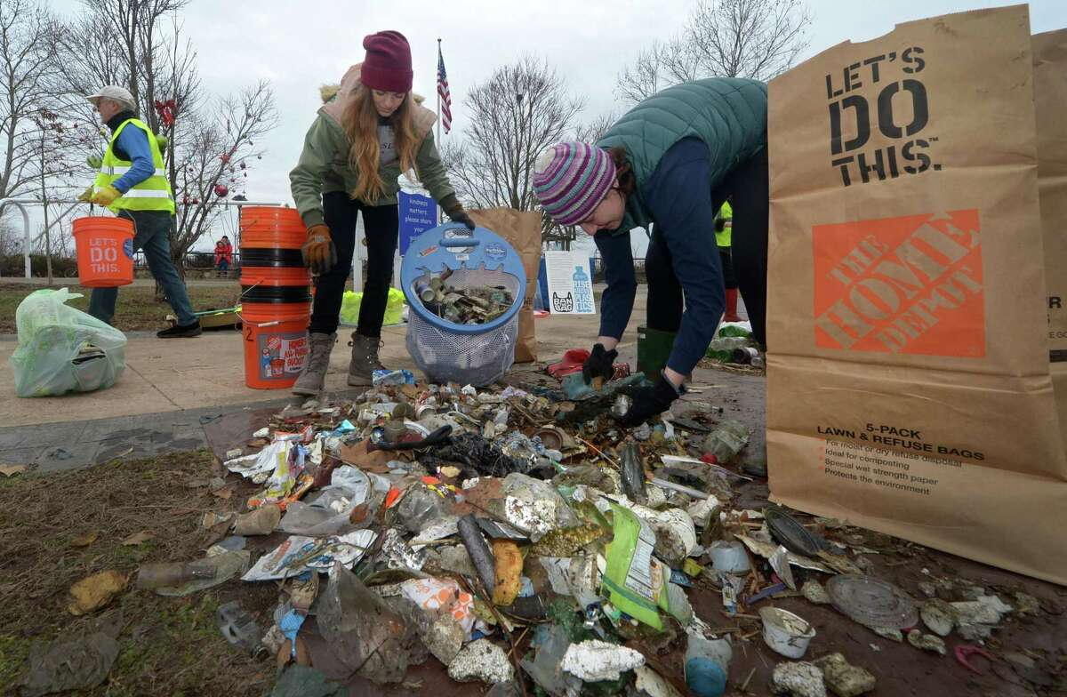 Volunteers Rachel Precious and Ginger Brooker sort garbage as Surfrider and SkipThePlasticNorwalk.org organize a cleanup of Oyster Shell Park in support of Norwalk's plastic bag ban Saturday, January 19, 2019, in Norwalk, Conn.