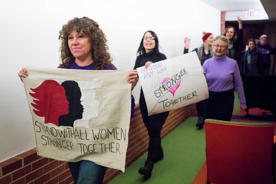 "People march around the auditorium during the ""Rally for Good,"" hosted by Women of Michigan Action Network, on Saturday, Jan. 19, 2019 at the Grace A. Dow Memorial Library Auditorium. (Katy Kildee/kkildee@mdn.net) Photo: (Katy Kildee/kkildee@mdn.net)"