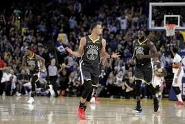 Stephen Curry (30) celebrates a three pointer in the second half as the Golden State Warriors played the New Orleans Pelicans at Oracle Arena in Oakland, Calif., on Wednesday, January 16, 2019.