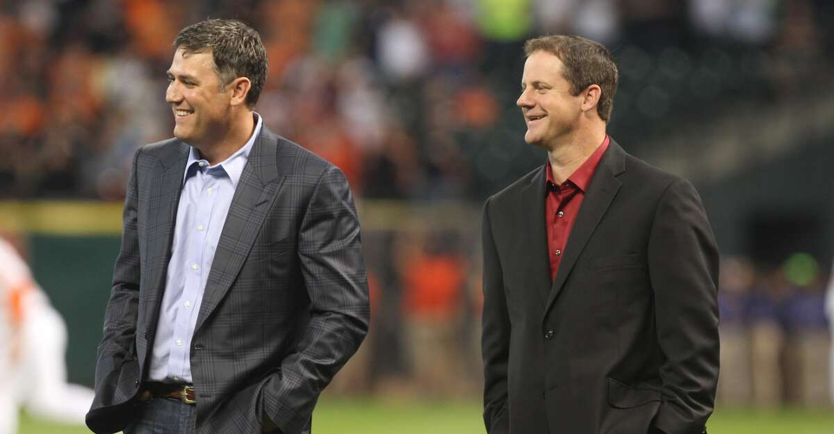 Former Houston Astros players Lance Berkman and Roy Oswalt during a ceremony recoginizing his contributions to the team before a MLB baseball game against the Los Angeles Angels Saturday. Berkman and former teammate Roy Oswalt signed one-day contracts so they could retire as Astros.