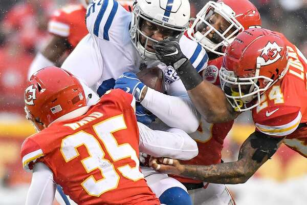 A pack of Kansas City Chiefs defenders tackle Indianapolis Colts tight end Eric Ebron in the second quarter during an AFC Divisional game on Saturday, Jan. 12, 2019, at Arrowhead Stadium in Kansas City, Mo. The Chiefs advanced, 31-13. (John Sleezer/Kansas City Star/TNS)