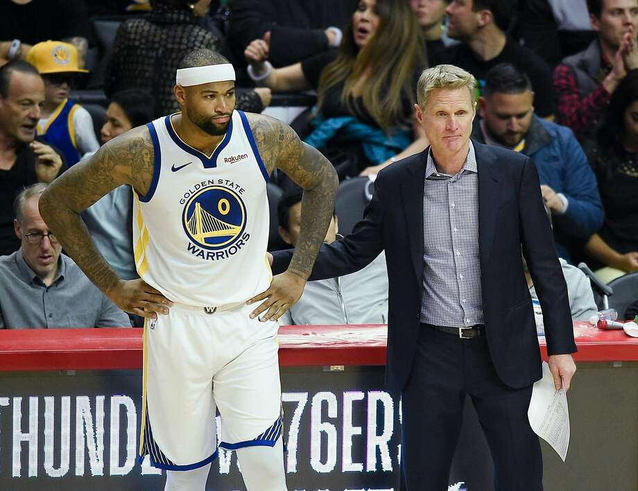 Golden State Warriors center DeMarcus Cousins, left, prepares to take the court next to head coach Steve Kerr to start the second quarter against the Los Angeles Clippers on Friday, Jan. 18, 2019 in Los Angeles, Calif. Photo: Kelvin Kuo / Special To The Chronicle