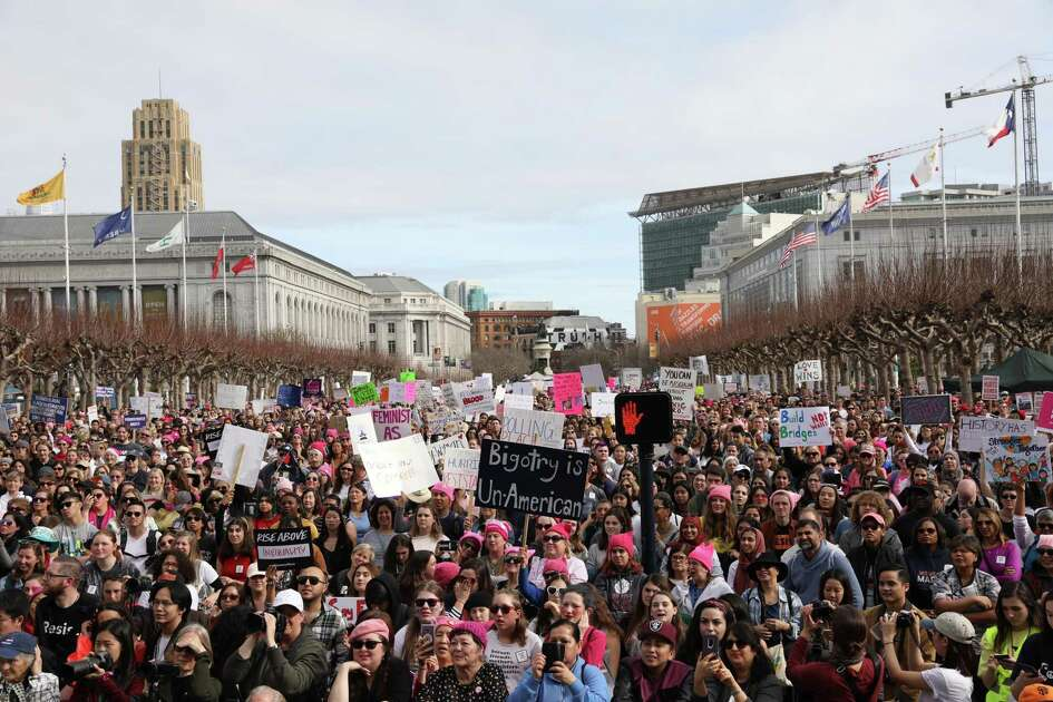 Thousands pack Civic Center Plaza as San Francisco Mayor London Breed delivers a speech during the Women's March rally.