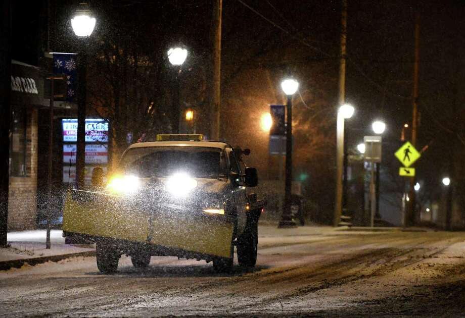 Snow starts to accumulate on Delaware Ave. at the Four Corners on Saturday evening, Jan. 19, 2019, in Delmar, N.Y. (Will Waldron/Times Union) Photo: Will Waldron, Albany Times Union / 40045982A