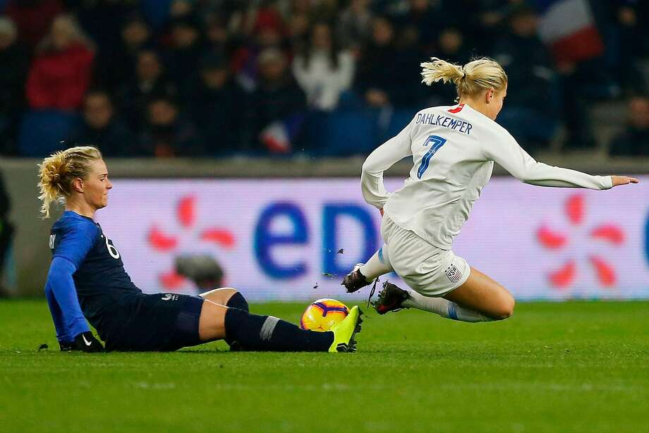 U.S. defender Abby Dahlkemper, who went to Sacred Heart in Atherton, is tripped up by France's Amandine Henry in a World Cup warm-up match Saturday. Photo: Charly Triballeau / AFP / Getty Images