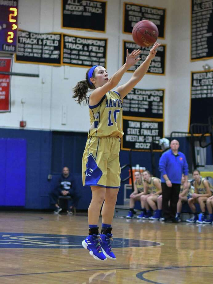 Cyleigh Wilson of the Newtown Nighthawks shoots a jump shot during a game against the Notre Dame Fairfield Lancers on Friday at Notre Dame Fairfield High School in Fairfield. Photo: Gregory Vasil / For Hearst Connecticut Media / Connecticut Post Freelance