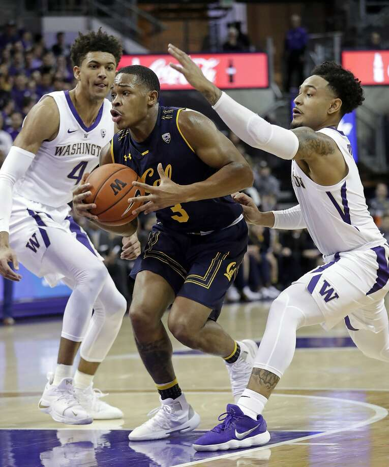Cal's Paris Austin drives between Washington's Matisse Thybulle and David Crisp in Seattle. Photo: Elaine Thompson / Associated Press