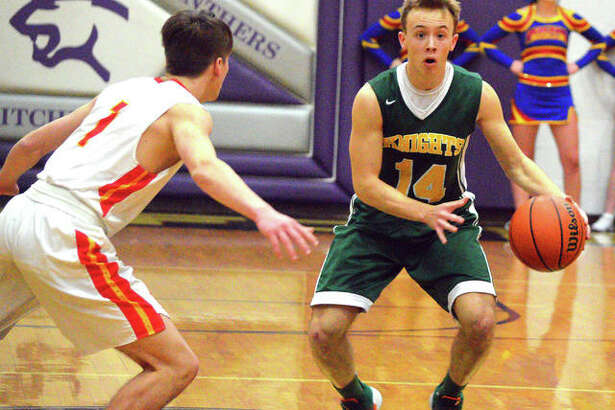 Metro-East Lutheran senior Jonah Wilson, right, tries to get past Roxana's Andrew Beckman during Saturday's fifth-place game in the Rick McGraw Memorial Invitational at Litchfield High School.