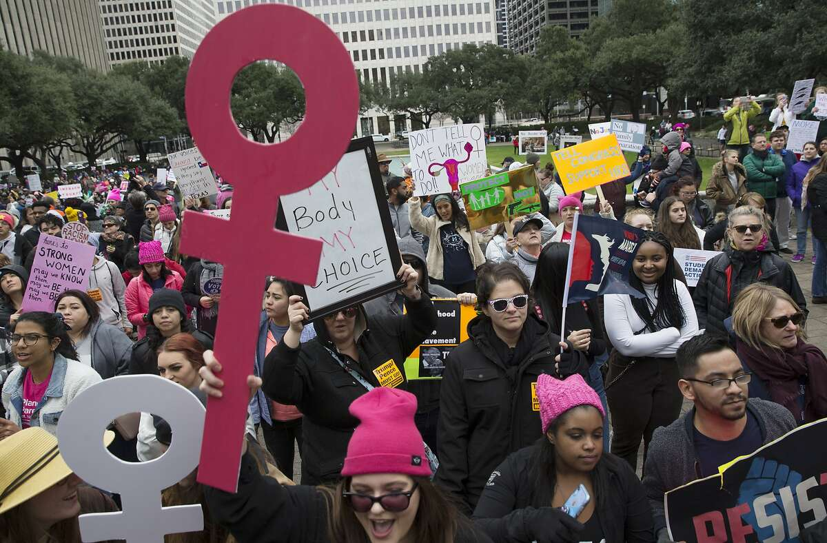 Houston Women March On participants bring homemade signs to rally at Houston City Hall on Saturday, Jan. 19, 2019, in Houston.
