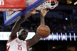 Houston Rockets' Clint Capela (15) dunks the ball against the Orlando Magic during the first half of an NBA basketball game, Sunday, Jan. 13, 2019, in Orlando, Fla. (AP Photo/John Raoux)