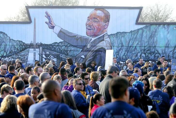 Marchers gather Monday January 15, 2018 before the 50th annual Martin Luther King Day march in San Antonio.