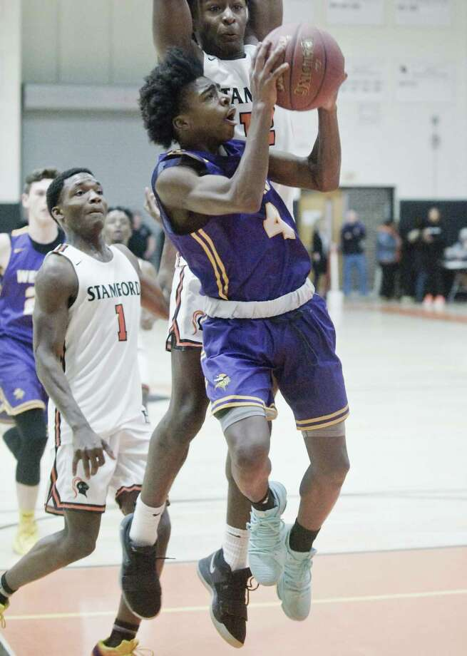 Westhill High School's JeySon Slade tries to get a shot off in a game against Stamford High School, played at Stamford High School. Saturday, Jan. 19, 2019 Photo: Scott Mullin / For Hearst Connecticut Media / The News-Times Freelance