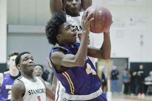 Westhill High School's JeySon Slade tries to get a shot off in a game against Stamford High School, played at Stamford High School. Saturday, Jan. 19, 2019