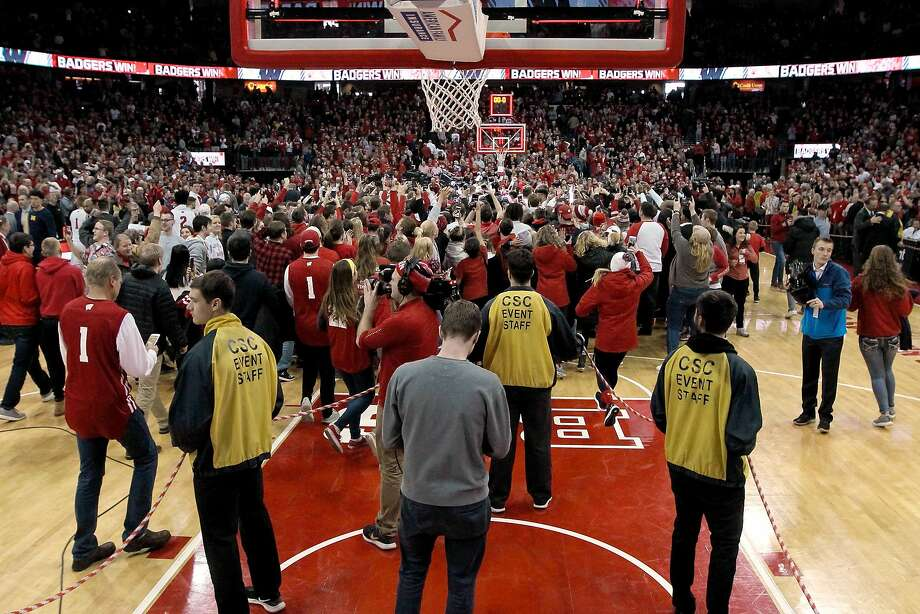 Fans in Madison rushed the court after Wisconsin defeated previously unbeaten Michigan. Photo: Dylan Buell / Getty Images