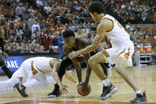 AUSTIN, TEXAS - JANUARY 19: Kristian Doolittle #21 of the Oklahoma Sooners fights for the ball with Jericho Sims #20 and Elijah Mitrou-Long #55 of the Texas Longhorns during first half action at The Frank Erwin Center on January 19, 2019 in Austin, Texas. (Photo by Chris Covatta/Getty Images)